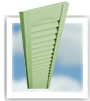 Exterior shutters with fixed vinyl louvers.